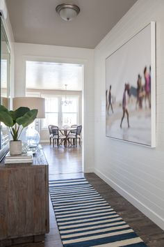 Alice Lane Home Collection | Daybreak Lake Loft | Ship lap plank walls in entryway, modern beach art | Lindsay Salazar Photography