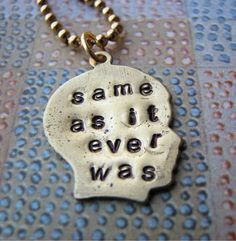 Talking Heads lyrics necklace.