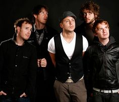 OneRepublic. One thing I notice is lead singer and songwriter Ryan Tedder usually has something that sets him apart from the others in the picture, wether it's what he is wearing, facial expression, or something else, he is unique.