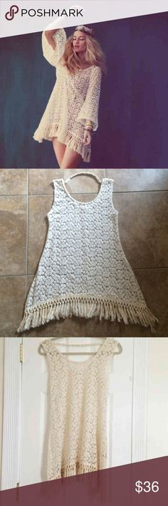 Boho gypsy lace crochet and fringe tunic dress Boho gypsy tunic dress!  Cream/tea lace and crochet with fringe bottom (almost a small Ombre effect).  The hem is slightly longer in the sides which I love!  Sleeves have been carefully cut off and you cannot tell at all, and it makes it so unique!  Wear with a slip under or over a bathing suit or even over jeans and a cami.  No size tag but fits like a small or XS.  Reminds me of free people! Dresses