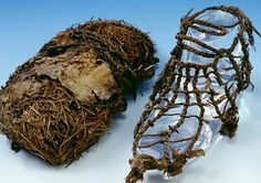 Ötzi's shoes.  They are the oldest of their kind in the world. The inner shoe is composed of grass netting. Its purpose was to hold hay in place which served as insulation material. The outer part is made of deerskin. Both parts are fastened by leather straps to an oval-shaped sole made of bearskin. Unlike the sole, the uppers were worn with the fur on.