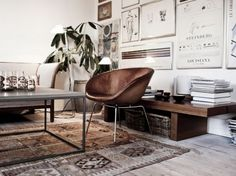 gorgeous shades of leathery browns with beautifully arranged art pieces, plants, books and baskets.