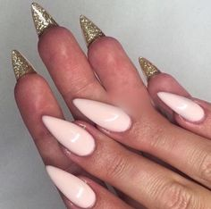Pink and gold nail design with a twist.