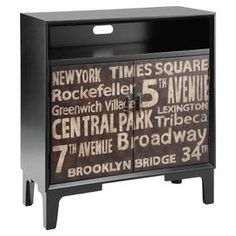 Two-door cabinet with a hand-painted text motif.   Product: CabinetConstruction Material: WoodColor: BlackFeatures:  Hand-painted text motifTwo doors Dimensions: 34.25 H x 32 W x 15.5 D