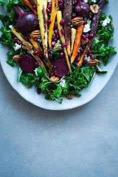 {Kale, roasted vegetables, ricotta and pomegranate super salad.}