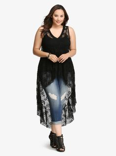 """This style is meant for grooving at a summer music fest. Intricate allover black lace is elevated (literally) by an extreme hi-lo style. Finished off with a flirty ruffled hem, throw this flowy v-neck over any 'fit and you'll get a boho upgrade.<br><br><b>Model is 5'10"""", size 1</b>"""
