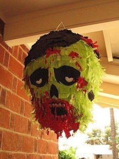 Zombie Pinata: Is it going to far to use a wooden machete to break these open?