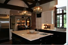 Another shot of the black and white kitchen.  Love the ceiling beams.