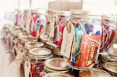 Mason Jars Filled With Candy As Wedding Favors (or teacher gifts . . . party favors . . . or . . . )