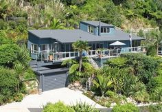 Watch the Dolphins! Tairua Home ( arial view) New Zealand, Oceana Heights, high on Mt. Paku, Coromandel Peninsula, perfectly positioned for stunning open views over the Surf Beach, Pacific Ocean and Islands. When location counts, it does not get much better than this. The breathtaking 180 degree of the ever-changing Ocean views from the entire appr. 20m length of this north facing, sunny and immaculately presented 3 bedroom home will sweep you away. Ocean views from all rooms. Spacious open…