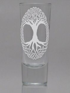 "Shot Glass Celtic Tree of Life - Tall design Sandblasted Engraved Etched Celtic 2oz. Enrich your home decor collection with this 2 ounce Shot Glass or customize it with your own image. This attractive engraving is ideal for any occasion and will be treasured for years to come and be truly distinctive. Price includes engraving on one side. Product Specifications: Model: CRISA Manufacture: LIBBEY Approximate Product Dimensions: 1 5/8"" x 4 1/8"" (Diameter at Top x Height) Capacity to fill…"
