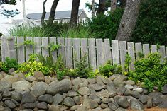 How to Get Rid of Ticks Around Your Home: 9 Steps (with Pictures)  I like this fence with the river rocks