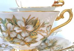 Vintage Royal Albert Tea Cup Trio, Bridal Shower Tea, Gold, Gold Teacup Set, Bridal Shower Tea Gift, Royal Albert China, Bridal Luncheon Well preserved and clean ~ free of cracks, chips and crazing. All of gold is intact. from when made. Royal Albert, Avon shaped wide mouth teacup