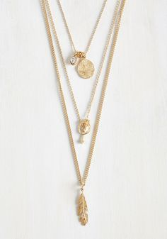Third Chime's the Charm Necklace. Practice makes perfect when it comes to your music, and this layered, gold necklace gives you the radiant poise you need to reach that high note. #gold #modcloth