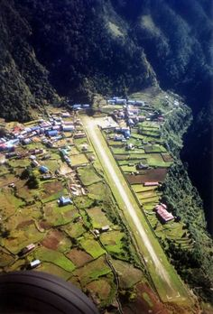 Lukla Airport , Nepal. Altitude 9,384' Length 1,500'. World's most dangerous airport. Sarah and Sri party