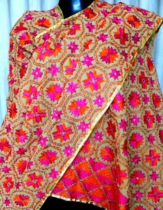 Look stunning in the bright and gorgeous color combination of this hand embroidered phulkari work dupatta. It has been heavily embroidered in the traditional geometric pattern of phulkari, with thread and sequins. It is big enough to be draped like a shawl, and can even be stitched into a gorgeous kurta. - See more at: http://giftpiper.com/Phulkari-Bagh-Work-Dupatta-Orange-Pink-Pattern-id-672346.html#sthash.NFBSlr25.dpuf