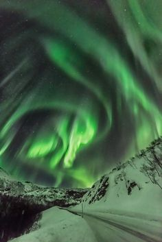 Exploding Solar Storm - Solar storm causes the aurora to explode and dance in the sky near Tromvik Norway