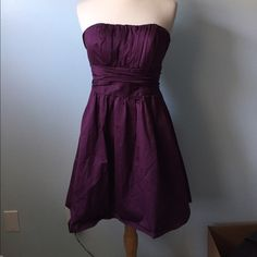 (A42) David's Bridal Plum Dress Classic a-line strapless dress by David's Bridal. Only condition issue is the hem likes to fold up and it does collect hair and lint easily. Zipper is perfect, dress is just a bit too small for my mannequin. ♡Please ask any questions! ♡Measurements and modeling available.  ♡Smoke free, pet friendly home.  ♡Please use the offer button to make offers! ♡NO TRADES! David's Bridal Dresses Midi