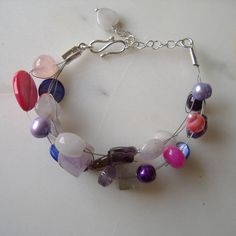 Colourful multistrand bracelet with gemstones, pearls and shell beads, February birthstone, adjustable pink, lilac and purple boho bracelet - pinned by pin4etsy.com