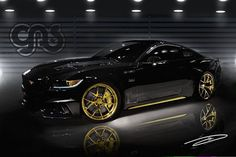 """2015 Ford Mustang GT """"The Specialty Equipment Manufacturers Association (SEMA) show in Las Vegas is happening soon, and Ford has released info on the modified Mustangs it's bringing to Sin City. Ford says it will bring over a dozen Mustangs, but only two have been shown thus far. One is from Galpin Auto Sports and it comes with a gold-flecked black paint job meant to honor the 50th anniversary of the Mustang. It also packs a 725-horsepower supercharged 5.0-liter V8 under the hood."""""""