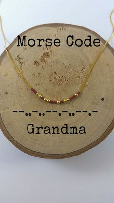 This dainty morse code necklace spell out GRANDMA. Gold plated beads and tiny crystal beads are used as dots and dashes. Its the perfect gift to express your feelings or how much the other person means to you. Very cute and simple. Lobster clasp end. The order includes: - 1 morse code necklace GRANDMA - 1 card with your secret message. There are multiple colors. Choose the one you like!!(The colors of the main picture are royal blue and turquoise) Available; - lengths : 14( aprox. 36...