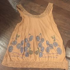 Anthropologie sequin top By Deletta. Gorgeous sequined top with blue floral design and ties in back. 100% viscose. Dry clean only. Anthropologie Tops Blouses