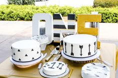 "Baby's first birthday fun!   Love this cake table! We used canvas letters from Michaels stores, painted  them and wrapped Recollections Decorate it gold washi tape around them to  go with the black white and gold ""Wild One"" theme!   For this adorable high chair banner, I used one pie"