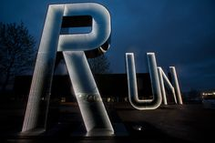 """""""I'm the Doctor. Basically...run""""       RUN sculpture (lit up at night) by Monica Bonvicini for the 2012 London Olympics that ends up looking like a warning from the Doctor.   Kudos to @Caroline Sharp for pointing this out (I'm lucky to have friends who think of Doctor Who as much as I do). (Doctor Who)"""