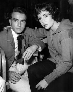 """Actress Elizabeth Taylor (b. 1932), with actor Montgomery Clift (1920-1966), on the set of Edward Dmytryk's film, """"Raintree Country,"""" 1957."""