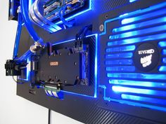 """This nicely put togetherwall-mounted PC is ultimately the goal of many custom computer builders. Recoil P calls it """"The RecoilMachine"""", which took him over 2 months to order and assemble the rig. Also according to Recoil P, he uses Plexiglass as the backplate for each component before having them planted firmly on a large vinyl-clad hardboard. RecoilMachine has single loop water-cooling setup, Gigabyte EX58-UDP5, Intel Core i7 920 Socket-1366, Asus GTX 590, Samsung 250GB 840 EVO SS..."""