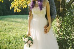 #DavidsBridal bride Erin in this tulle a-line gown with high lace neck |  Antique Inspired DIY Wedding · Rock n Roll Bride