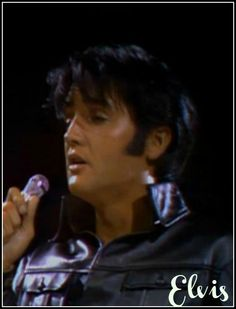 """Elvis in the iconic """"black leather"""" suit."""