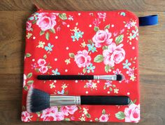 Red floral makeup bag by DeeliciousCrafts on Etsy