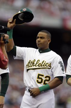 American League outfielder Yoenis Cespedes, of the Oakland Athletics, waves to the crowd before the MLB All-Star baseball game, Tuesday, July 15, 2014, in Minneapolis. (AP Photo | Jeff Roberson)