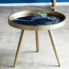 Transform your space with the natural swirls and characteristics of marble with the luxurious Husten Side Table, Black from Phil Bee Interiors.