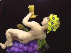 Dionysus, the Greek God of the grape harvest and wine, of fertility and ecstasy:  wool figure with wire armature (by Kathleen Dodge-DeHaven)