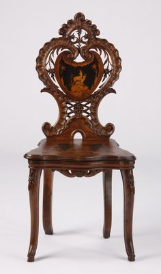 Late carved walnut marquetry inlaid Black Forest side chair, with pierce carved back and marquetry inlaid seat and backrest.
