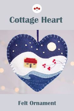 A handmade felt Christmas heart ornament, embroidered with a traditional Irish cottage in a snowy winter landscape, under a full moon and starry night sky.The heart measures approx. 4 inches / 10cm across, and has a cotton loop for hanging.The price includes worldwide shipping.#feltchristmasornaments Scandi Christmas, Christmas Hearts, Felt Christmas Ornaments, Irish Cottage, Starry Night Sky, Irish Traditions, Heart Ornament, Felt Hearts, Handmade Felt