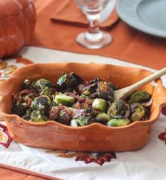 Start a new side dish tradition this Thanksgiving/Friendsgiving season and serve these tasty roasted Brussels sprouts with bacon and onion. They are quick and easy to make, which will free up time to spend with family and friends. The secret to this delicious side dish lies in tossing the Brussels sprouts in bacon grease before cooking, delivering a perfectly seasoned, crisp-tender vegetable that will delight everyone at the table. #ad #InspiredGathering