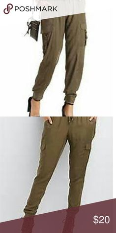 Olive Drawstring Cargo Jogger Pants Lightweight rayon joggers in fun cargo style! Elastic drawstring waist and rib knit ankle cuffs. Side pockets, one zip back pocket, and front flap cargo pockets. Fits like a L/XL. Charlotte Russe Pants Track Pants & Joggers