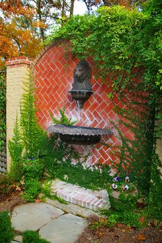 Adorable Wall Fountains Ideas With Unique Designs : Outdoor Wall Fountains With Lion's Head Statue And Herringbone Brick Design