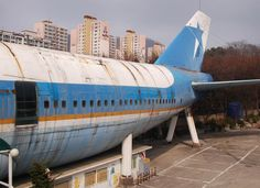 Apparently old airplanes are sometimes converted into restaurants. this one's in south korea. pretty surreal