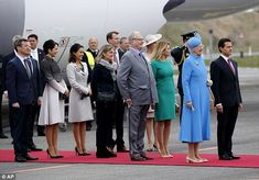 President of Mexico Enrique Pena Nieto (right) and his wife Angelica Rivera de Pena (fourth right) are welcomed by Denmark's Queen Margrethe (second right) Prince Henrik (sixth right) Crown Prince Frederik (left) Crown Princess Mary (third left), Prince Joachim and Princess Marie at Copenhagan International Airport