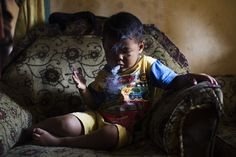 ADDICTING SMALL CHILDREN TO NICOTINE | Marlboro Boys: Indonesia's Youngest Smokers Light Up | Mother Jones
