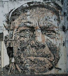 Portuguese street artist Alexandre Farto, aka Vhils, who makes his portraits by carving into bare walls of old buildings.