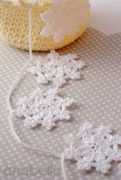 Crochet snowflakes garland by Anabelia - chart provided. Can make individual ones for tree decorations or string together for a garland?