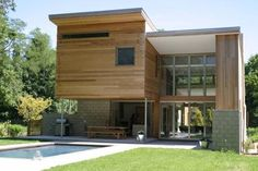 This house conserves energy, sequesters solar heat, pumps groundwater up to both heat and cool, is made of structural insulated panels (not convention framing), has a saline pool, sleeps a half dozen, entertains more and ain't frumpy