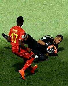 Sergio Romero of Argentina against Divock Origi of Belgium