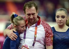 Russia's Victoria Komova (L) is consoled by her coach after she missed out on a gold medal as team mate Aliya Mustafina (R) looks on during the women's individual all-around gymnastics final in the North Greenwich Arena during the London 2012 Olympic Games August 2, 2012. (REUTERS/Dylan Martinez)