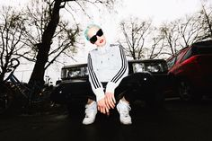 Russian Squat  Tracksuit Top: Adidas  Vinyl Pants: Mango  Sunglasses: LeSpecs  Nike Air Force 1: here & here    Photos by Carlos Fernandez Laser